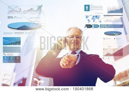 business, statistics and people concept - senior businessman calling on smartphone an looking at wristwatch in city with charts