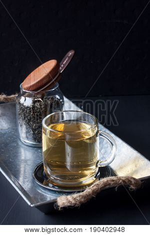 Green tea with glass mug on a black background