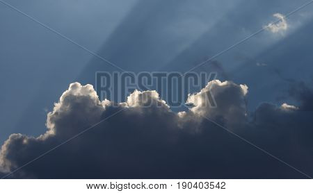 Photography Clouds, Clouds backlit with sun rays coming out, blue sky, storm clouds, cottony,