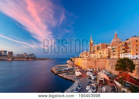 Valletta Skyline with church of Our Lady of Mount Carmel and St. Paul's Anglican Pro-Cathedral, at beautiful sunset, Valletta, Capital city of Malta