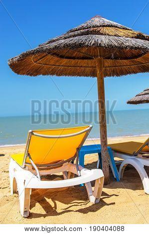 Beach umbrellas and deckchair on the tropical beach