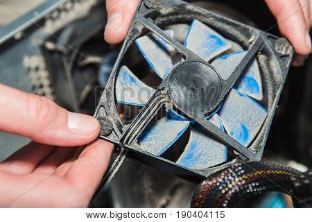 Computer literacy repair man's hands, man examines laptop PC clean dust pollution