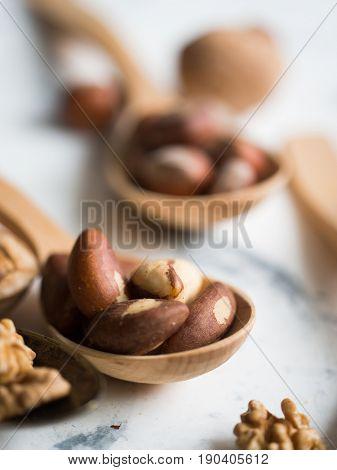 Brazil nuts in wooden spoon