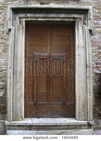 Old Wooden Door In Assisi, Italy