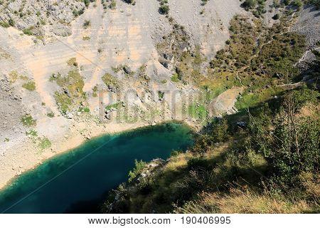 hiking to the blue lake of Imotski in Croatia