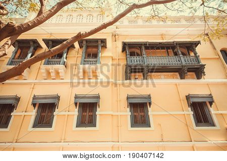 Old buildings of indian city Mysore. Traditional style of design with wooden balconies, India