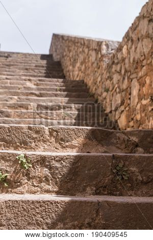 Stone stairway of a medieval fortress .