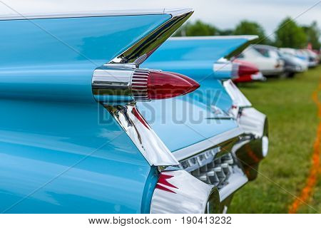 PAAREN IM GLIEN GERMANY - JUNE 03 2017: Rear stoplights of a full-size luxury car Cadillac Coupe DeVille 1959 (focus in the foreground) Exhibition