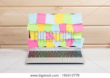Random Blank Sticky Notes Covering A Laptop