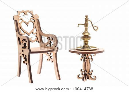 Ancient Golden Jug On Decorative Wooden Table With Chair