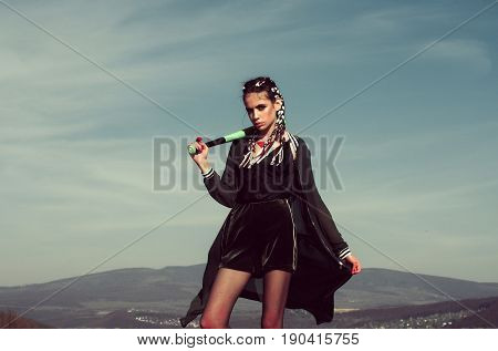 Woman With Baseball Bat On Blue Sky