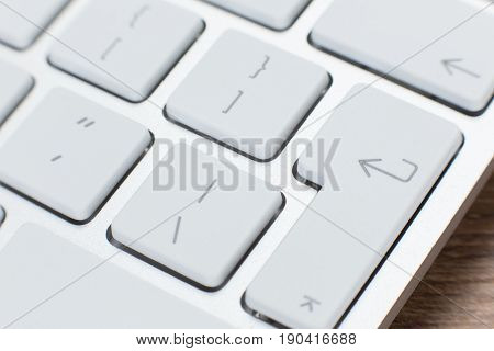Detail Of The Keys On A White Laptop Keyboard