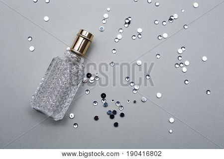 Perfume of female Bottle over grey background