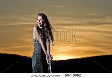 Happy Girl Smiling On Yellow Sky