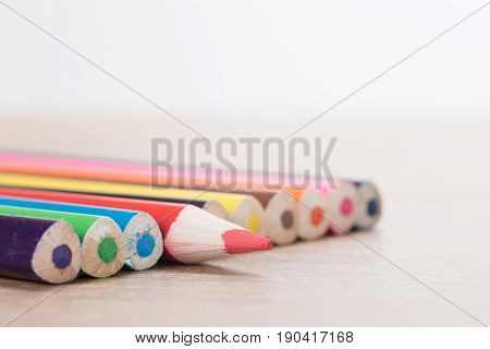 Colour Pencils On Table, With One Sticking Out