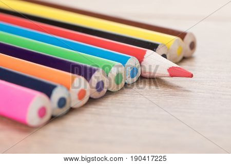 Row Of Color Pencils On Table Surface