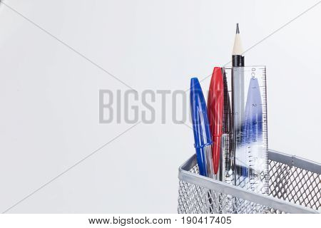 Pens And Pencils In A Wire Mesh Desk Tidy