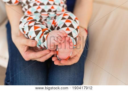 baby feet in mother hands. Infant baby boy
