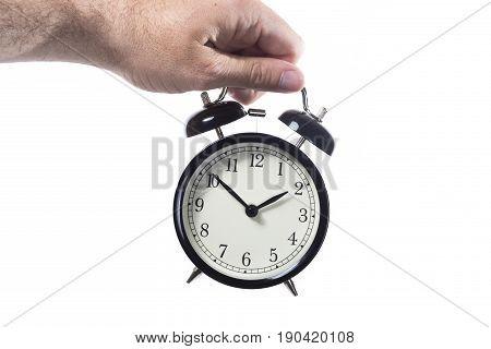 Man Holding A Retro Style Alarm Clock