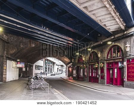 LONDON, UNITED KINGDOM - March 19, 2017: Pubs in Crutched Friars Street under the bridge of London Fenchurch station in London, England