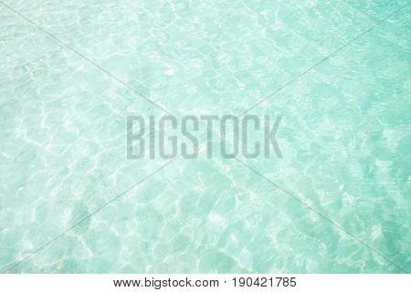 Crystal clear and turquoise sea water of the tropical sea .