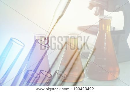 scientific experiments Laboratory equipment and test tubes- science concept