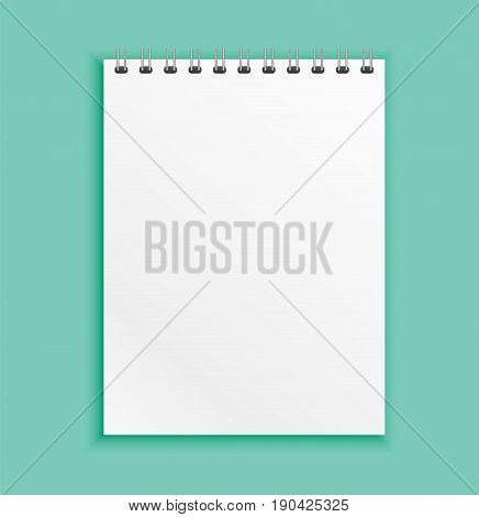 Template with spiral notebook isolated on a green background. School notebook. Realistic Notepad. Vector stock.
