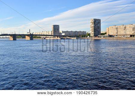 Volodarsky Bridge and Oktyabrskaya Embankment on outskirts of Saint Petersburg at evening Russia.