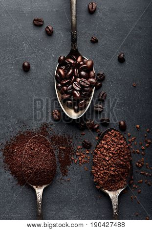 Coffee powder, instant, beans on dark board.