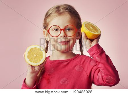 Smiling girl nutritionist holding fresh lemons. Concept of diet and healthy nutrition.