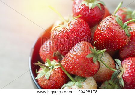 Beautiful and resh strawberries on wooden table