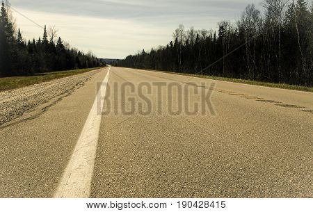 Road To Nowhere. Remote two lane highway through the forested wilderness of Michigan's Upper Peninsula.
