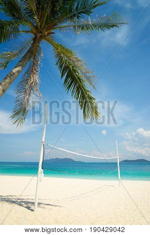 Rawa Beach with beach volleyball court in sunny day world famous destination beautiful weather and idyllic tropical island .