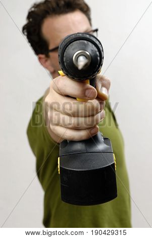 A Man with a cordless screwdriver in his hand