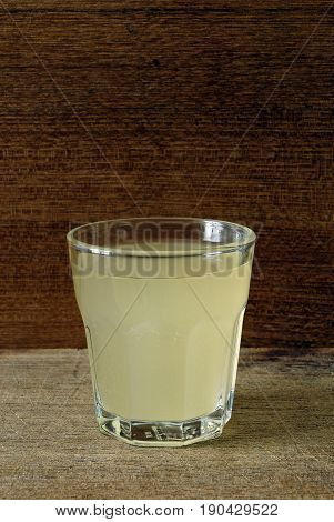 A glas of new wine on a wooden ground
