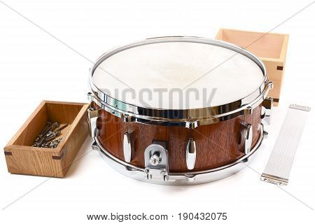 Brand new handmade wooden drum and spare parts in wooden box and snare wire isolated