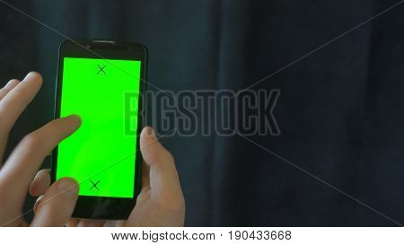 Close-up of male hands touching of smartphone. Green screen Chroma Key. Close up. Tracking motion. Vertical. pants. - Swipe left right animation black 6.