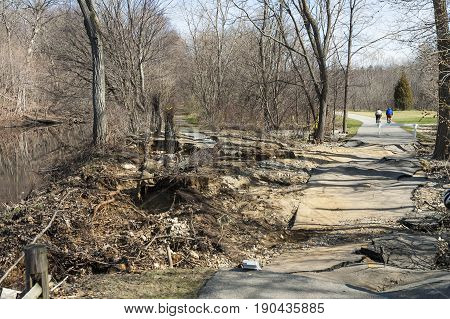 Lincoln Rhode Island USA - April 22 2007: Recent severe storm buckled pavement on Blackstone River Bikeway