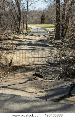 Buckled pavement on Blackstone River Bikeway after storm in April 2007