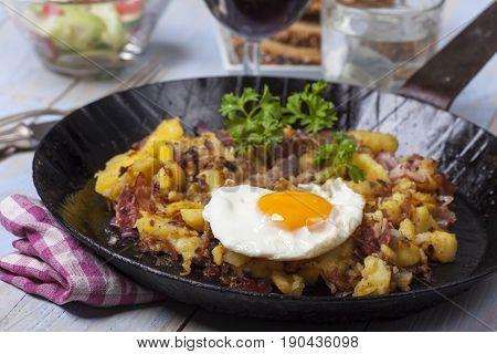 tiroler groestl a potato dish with an egg