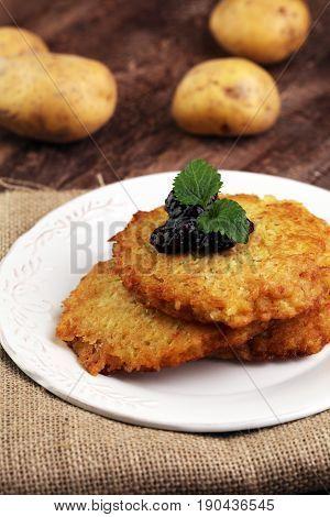 Potato Pancake With Cow Berry Sauce, Selective Focus