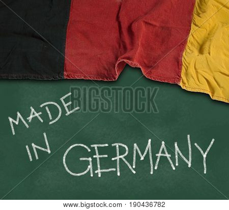 german flag and claim made in germany on chalkboard