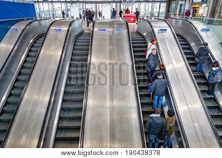 London UK - May 16 2017 - Escalators with commuters at North Greenwich underground station