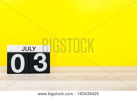July 3rd. Image of july 3, calendar on yellow background. Summer time. With empty space for text.