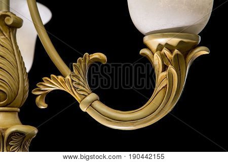Classic chandelier isolated on black background. Chandelier lamp for the living room interior. Close-up photo
