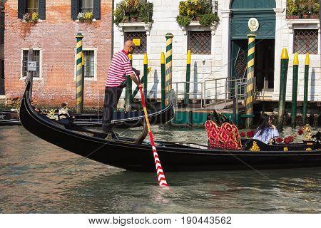 VENICE, ITALY - MAY 23, 2017: Gondolier on a gondola, Grand Canal in Venice, Italy