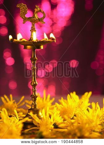 traditional indian oil lamp with purple background