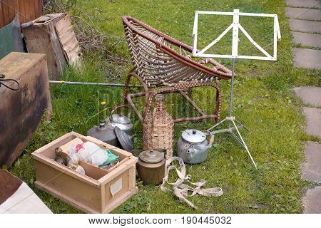 Various unwanted items spread out in a backyard outdoor image
