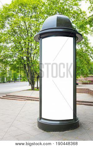 Mock up. Retro style street advertising column stand on sidewalk