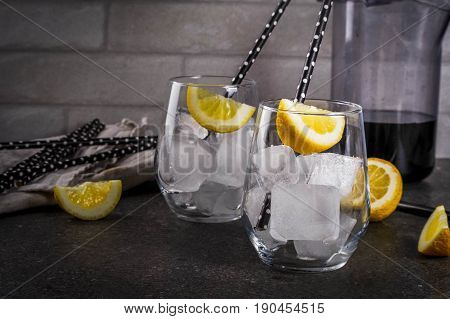 Black Lemonade With Ice And Lemon